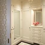 closets - glamorous closet vintage crystal chandelier ivory rug ivory cabinets drawers  Glamorous closet with ivory rug, ivory cabinets and drawers,