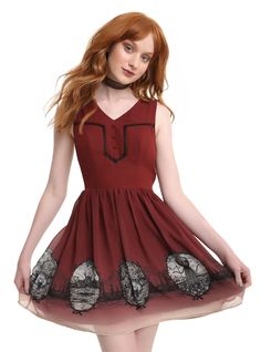 <div>This beautiful burgundy ombré dress just looks like a crisp fall day and perfectly captures the spirit of <i>Over the Garden Wall</i>. The soft v-neckline gives way to a fitted bodice that has a black lace chest insert and decorative buttons. There's sheering in back, to keep the dress comfortable and add some texture. The tufted circle skirt has pockets and features hand drawn scenes inspired by the new Halloween classic including Wirt and Greg in the...