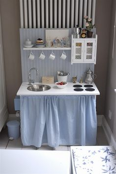 I love the shelf, cup hooks, and chicken wire in the cabinet!