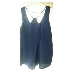 RUE 21 LADIES SILKY TOP Size L. Runs true to Size.  Top is in like new condition. Rue 21 Tops