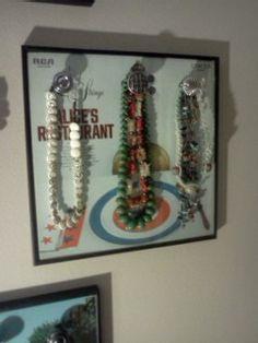 necklace organization. knobs on framed vinyl