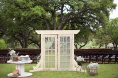 Outdoor wedding ceremony idea: antique French doors and other vintage country finds set the stage.    Glamorous, Vintage, Rustic Texas Barn Wedding | Venue: Cherokee Rose