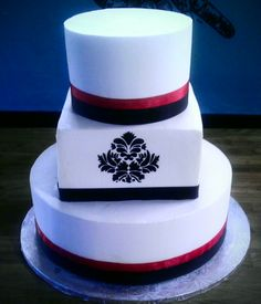 White, black and red Fleur de lis Damask wedding cake