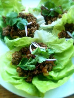Lamb, cooked onions, raw onions, cilantro & Hot Sauce Lettuce Tacos.