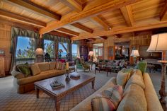 LHM Lake Tahoe - Bask in the solitude of this private 10-acre gated estate with a magnificent main house and separate guest house. The incredible woodwork, leaded glass windows and custom trompe l'oeil painting reflect the creativity and craftsmanship that went into every room.
