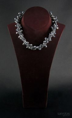 Isis Sparkling Silver - A beautiful blend of briolette and teardrop crystals interwoven into majestic harmony.
