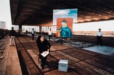 """In 1968, Lina Bo Bardi, 54, at the MASP construction site with Van Gogh's """"The Postman's Son,"""" 1888, on her signature Arte Povera easel. Photograph © MASP. Click above to see larger image."""