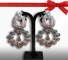 Rs.660.00 / $11.88 Shipping Charges 	Free Shipping To India(IND)	 Product Details 	 Silvery and modern look for divas with this pair of silver earing jewelry/ jewellery with blue beads. http://www.giftsomeone.com/product_info.php?products_id=3664