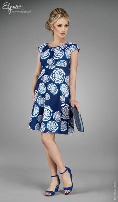 This stunning floral dress is perfect for any special occasion. It features a…