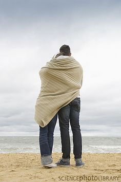 Image detail for -Couple hugging on beach - F004/3572 - enlarged - Science Photo Library