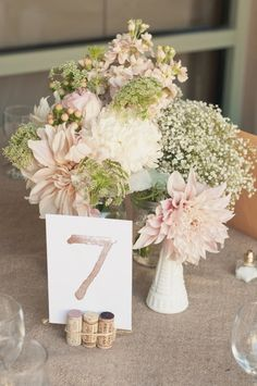 Gorgeous flowers and a wine cork table number holder