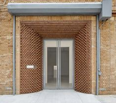 The perfect grey to go with orange brick. SO-IL adds decorative brick entrance to Tina Kim Gallery gallery in Manhattan. Brick Design, Facade Design, Exterior Design, Architecture Design, Pavillion, Brick Art, Brick Detail, Exposed Brick Walls, Brick Facade