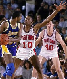 Magic Johnson, Dennis Rodman and Bill Laimbeer (Detroit Pistons)