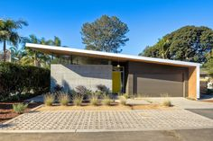 Southern California beach home features angled roof with crescent cutout