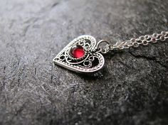 Garnet necklace,Small silver necklace,heart necklace, garnet tiny pendant,garnet silver necklace, israeli jewelry,necklaces by MorSilverJewelry on Etsy https://www.etsy.com/listing/158942535/garnet-necklacesmall-silver