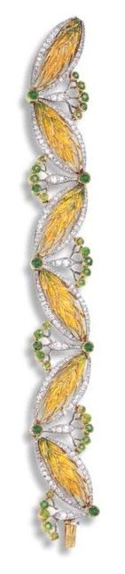 AN ART NOUVEAU ENAMEL, DIAMOND AND DEMANTOID GARNET BRACELET, BY BOUCHERON. Composed of a series of yellow and green enamel wheat sheaf links, enhanced by old European-cut diamond borders, joined by similarly-set spacers of foliate design, accented by demantoid garnet collets, mounted in platinum and 18k gold, circa 1910, with French assay marks and maker's mark, in a Boucheron blue leather case. Signed Boucheron Paris | JV