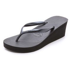 850526a14 Classic Havaianas flip flops gain flattering height with a platform wedge  elevating the silhouette.