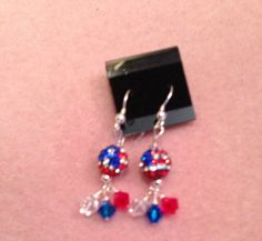 "Shannon T. created these ""Red, White and Blue Pride"" earrings for the Artbeads patriotic design contest. You can enter this contest along with a contest sponsored by SWAROVSKI ELEMENTS with your own patriotic design. Learn more here: http://www.artbeads.com/swarovski-artbeads-contests.html"