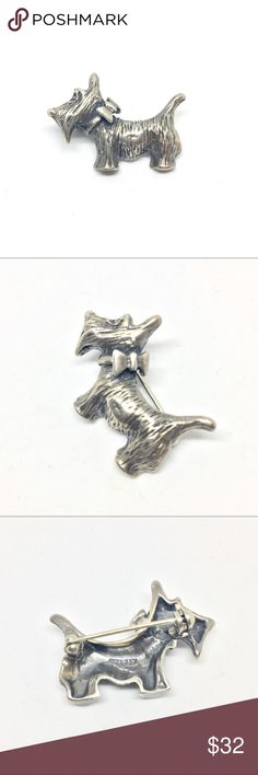 """Sterling Silver Vintage Scottie Dog Pin True vintage 925 sterling silver Scotty dog brooch pin. Pictures the profile of the dog wearing a bow collar. Textured with fur detailing all over. Signed 925 on the back. Pin is in perfect condition. Measures 1 1/4"""" wide by approximately 3/4"""" tall at tallest point. Vintage Jewelry Brooches"""