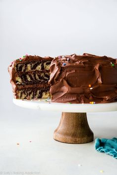 How to make chocolate and vanilla zebra cake! Topped with creamy chocolate cream cheese frosting, this easy, moist, and delicious cake is a showstopper! Recipe on sallysbakingaddiction.com