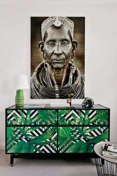 Statement furniture can be off-set against statement artwork without being overpowering, as seen in this stunning example. #GreenFurniture #GreenStorage #GreenHomeDecor