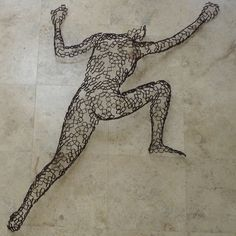 Female Rock Climber by Rainer Lagemann:; created of segments of steel pipe cut crossways.