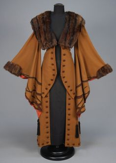 WOOL COAT with APPLIQUE and FUR TRIM, EARLY C. Light brown with exaggerated wizard sleeve appliqued in darker brown with black silk tassels, fur collar and cuff, contrasting faux button trim and satin lining. Perhaps not for everyday Retro Mode, Mode Vintage, Antique Clothing, Historical Clothing, Vintage Coat, Looks Vintage, Edwardian Fashion, Vintage Fashion, Beautiful Outfits