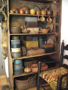Cupboard with collection of primitive bowls, pantry boxes...