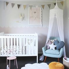 Lovely nursery by @beaumondemama. White Lanna Canopy, Mix beige garland, stars and hearts cushions by Numero74 Source: @lovelittleco