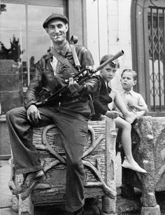 A French resistance fighter poses with his British-supplied Bren gun at Châteaudun, south-west of Paris, August 1944; After the Allied invas...