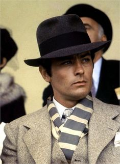 ALAIN DELON LOOKING SMART. THE HOKEY POKEY MAN AND AN INSANE HAWKER OF FISH BY CONNIE DURAND. AVAILABLE ON AMAZON KINDLE.
