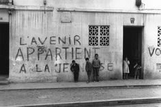 """Love the contrast between the writing and the setting (the writing says """"The future belongs to the youth""""). Photograph by Mario Dondero."""