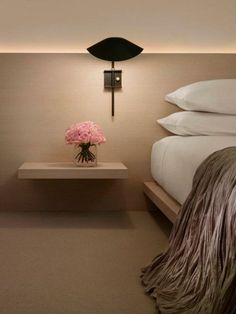 Bedside wall sconce by Serge Mouille. Available at Morlen Sinoway Atelier - Chicago.