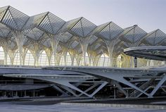 Calatrava. Oriente Station, Lisbon, Portugal. Constructed for the 1998 Expo in Lisbon, Portugal, Oriente Station is one of Europe's most comprehensive transport nodes, incorporating high-speed inter-city trains, rapid regional transport, tram and bus networks. The project's most distinctive feature, and symbol of the city's renewal, is a 78 x 238-meter steel and glass canopy covering eight elevated tracks and platforms. The bus station, metro station, car park, and commercial gallery are...