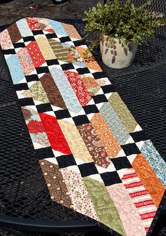 Sticks and Stones Runner. Could be a good design for a Christmas Tablerunner.