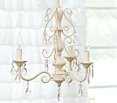Thinking about this chandelier from Pottery Barn Kids for Maya's room... white with lights pink crystals :)