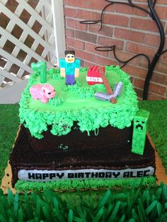 "Alec's 7th birthday cake. Minecraft. Publix made the cake from a picture I took them. It is vanilla cake with chocolate icing with chocolate cake crumbs(dirt). Then green buttercream overlay. They made an edible overlay from the ""Happy Birthday Alec"" i printed using a Minecraft font. The fondant characters were ordered from Etsy."