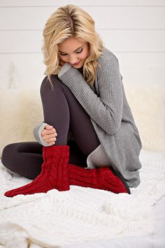 Soft, warm, cuddly cable-knit. You will be so glad you have these adorable slipper socks when you are snuggled up this winter. These slipper socks will keep your warm, comfortable and looking so stylish.Colors:RedTaupeIvorySmall/Medium Fits Shoe Size 4-7Medium/Large Fits Shoes Size 8-10Slip Resistant Bottom80% Acrylic 20% Polyester