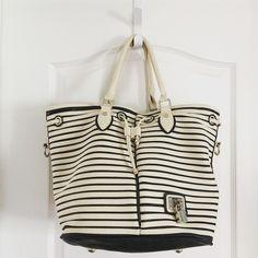 "Street Level Black & White Stripe Hobo Bag Street Level Oversized Handbag  ·         Black and white stripe ·         Magnetic snap closure and drawstring feature ·         Foot pedestals ·         2 interior slip pockets ·         Interior zipper pocket ·         Measures 16.5""x9""x12"" ·         Strap 7"" Street Level Bags Hobos"