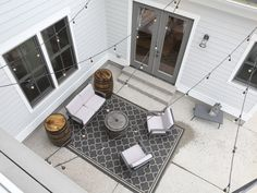 An overview of the outdoor sitting area with fire pit