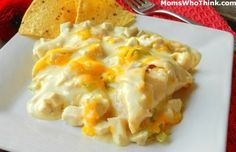 Easy 30 min meal Chicken Enchilada Casserole Recipe made with bag of tortilla chips, chicken, cream of chicken soup, milk, cheese, and green chilies