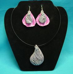 "Another gorgeous piece from Cindy Leitz's Faux Abalone tutorial which I titled ""On The Half Shell"" The earrings are nestled on a bright pink shell with a stand alone pendant. All silver wire findings and the pendant hangs on a black wire necklace."
