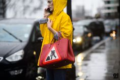 Street Style: London Fashion Week - Argentinian stylist Sofia Sanchez de Betak in Topshop raincoat and Anya Hindmarch bag - before TopShop Unique