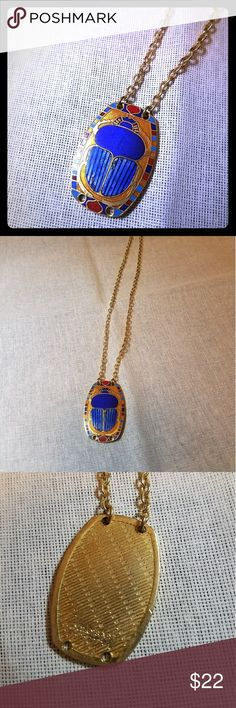 "Cloisonne Scarab Vintage Necklace Signed @Cloisart vintage Scarab necklace in excellent condition. The Scarab itself is an 1 1/2"" in Length and an inch wide. The chain itself is 9"". It doesn't really have room for adjustment. Some fading of the enamel on the wings. Truthfully I bought it that way so I'm unsure if that's on purpose or not. I like the look at it gives the wings depth with the stripping and color variation . Vintage Jewelry Necklaces"
