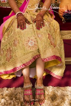 gold paayal , anklet , payal , banarsi lehenga for mehendi , yellow silk lehenga , pink kohlapui chappals ,