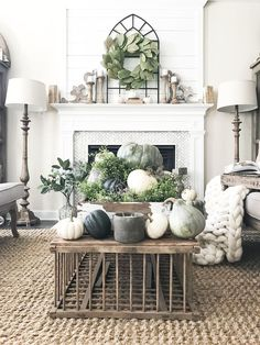 Love the fall decorations on the coffee table (which is super cute BTW), the rug and the mantle. Such a gorgeous look! #farmhouse #fall