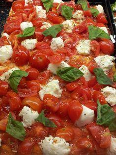 Thin crust Italian pizza with fresh tomatoes, basil and feta cheese - in Tel Aviv, Israel
