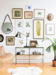 I like the gallery wall and table. The feather print would be good in the frames beside the windows.