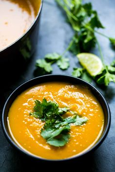 Roasted kabocha squash soup, thick and creamy, with ginger, cumin, and coriander. Perfect for fall! On SimplyRecipes.com