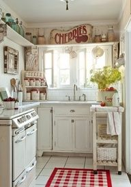 Lovely Shabby Kitchen..big sign above cabinet